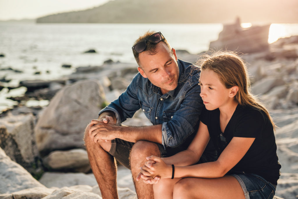 foster father taking time to mentor his foster daughter